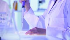 Close Up Hands Medical Researcher Conducting Tests - stock footage