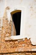 Stone wall window - stock photo