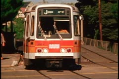 San Francisco, 1970's, Muni Trolley, close up, zoom back as trolley passes Stock Footage