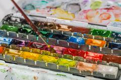 watercolor paint box with brush - stock photo