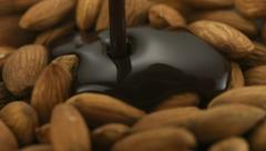 Chocolate sauce on almond, Slow Motion - stock footage