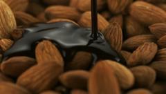 Chocolate sauce on almond, Slow Motion - stock footage