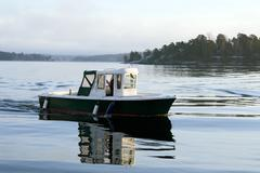 Motorboat on calm water Stock Photos