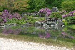 Blooming japanese garden reflecting in pond - stock photo