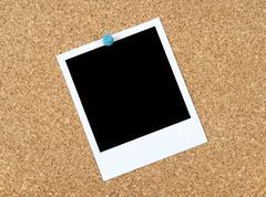 Blank photo on a corkboard Stock Photos