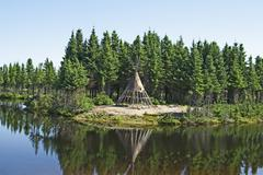 Native American tipi on a lakeshore Stock Photos