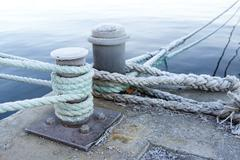Bitts and mooring lines - stock photo