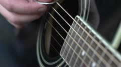 Guitar strings strummed in Slow motion Stock Footage