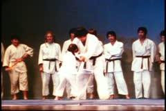 San Francisco, 1970's, Japantown, judo demonstration, young girl, big man Stock Footage