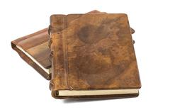 Precious books with a noble leather and wooden cover Stock Photos