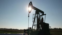 Pump Jack Against the Sun Stock Footage