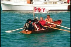 San Francisco, 1970's, Columbus Day Festival, boat with Columbus rowing in Stock Footage