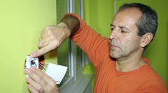 Electrician Installing an Electrical Switch - stock footage
