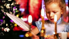 Girl writing with quill pen. Xmas concept - stock footage