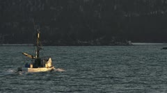 Fishing Boat Heading Out in Alaskan Bay Sunset Stock Footage