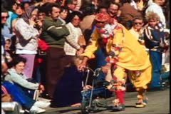 San Francisco, 1970's, Columbus Day Parade, clown pushing a tiny bicycle Stock Footage