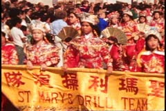 San Francisco, 1970's, Columbus Day Parade, Chinese girls carry banner Stock Footage