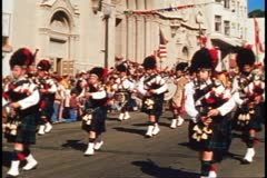 San Francisco, 1970's, Columbus Day Parade, Scottish bagpipers pass by Stock Footage