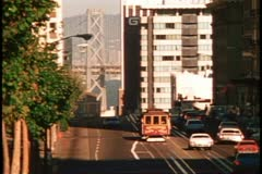 California Street cable car with Bay Bridge in San Francisco, 1970's Stock Footage