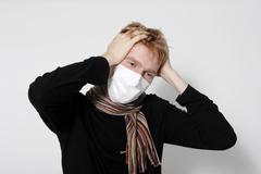 man with a headache, suffering from flu - stock photo