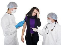 Women getting a flu shot from his doctor Stock Photos