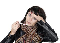 girl with a headache, suffering from flu - stock photo