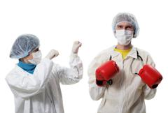 doctor in red boxing gloves fighting against influenza - stock photo