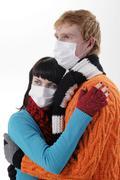 Man embraces a woman wearing masks, flu, Stock Photos