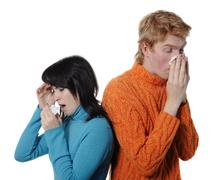 Sick flu man and woman, sneeze on each other Stock Photos