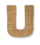 "the letter ""u"" is made of coarse cloth. - stock photo"