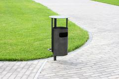 green grass, refuse bin - stock photo