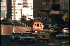 Nob Hill with the California Street cable car with cars in San Francisco, 1970's Stock Footage