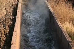 Hot wastewater flows through the channel Stock Footage