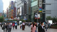 Chinese People Crowded Nanjing Road in Shanghai China Pedestrian Shopping Street Stock Footage