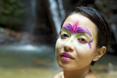 Tribal face painting in jungle Stock Photos