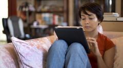 Girl touching tablet computer screen Stock Photos