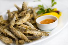 Fried sprat with souce Stock Photos