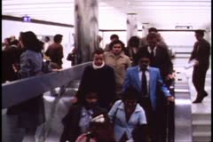 San Francisco, 1970's, BART, subway, people down escalator Stock Footage