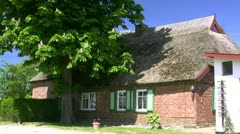 Old Thatched Roof House at the Baltic Sea - Northern Germany Stock Footage