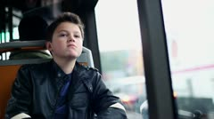 Sad, pensive boy riding bus in the city HD Stock Footage