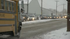 Weather, morning slow traffic in early winter snowy drive Stock Footage