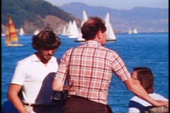 Sausalito, 1970's, two people stand on dock, sailboats in background Stock Footage