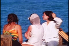 Sausalito, 1970's, three women watch bay, medium close up Stock Footage