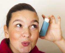 Girl with asthma inhalator Stock Photos