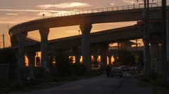 Close Up - Time Lapse of Sunset by the Skytrain bridges in Richmond, BC, Canada Stock Footage