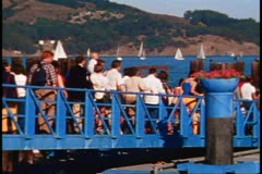 Sausalito, 1970's, gangway, people board ferry, zoom back to ferry boat Stock Footage