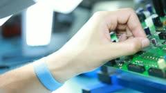 Technician solders circuit board 3 Stock Footage