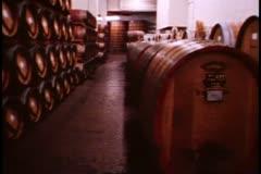 Napa, 1970's, Cask room, no people, huge oak barrels, wide shot, pan left - stock footage