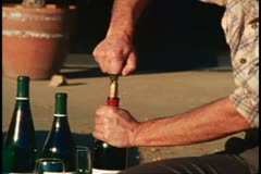 Napa, 1970's, Napa Valley, tasting wine, open bottle zoom out man pours - stock footage