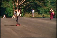 San Francisco, 1970's, Golden Gate Park, skater twirling around on road Stock Footage